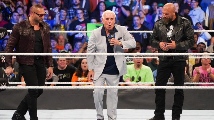Ric Flair with Batista and Triple H